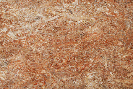 The texture of the pressed wood. Background of pressed wood shavings.