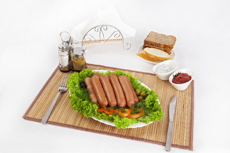 Sausages smoked with tomatoes, cucumbers and greens. Served with black or white bread. A perfect addition is a hot sauce and mustard. This dish for dinner gives strength and cheerfulness.