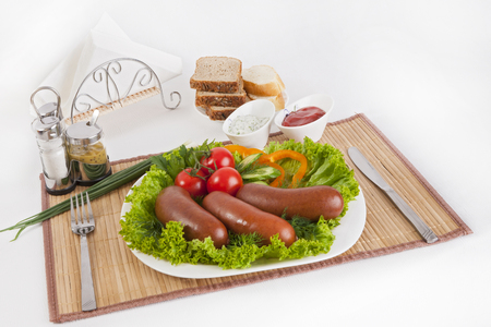 Boiled sausages with tomatoes, cucumbers and greens. Served with black or white bread. A perfect addition is a hot sauce and mustard. This dish for dinner gives strength and cheerfulness.