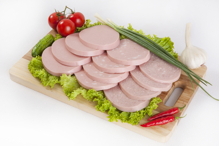 Sausage boiled with greens, tomatoes and cucumbers. Served with black or white bread. Sandwiches with sausage are an easy and healthy breakfast at the beginning of the day giving strength and vivacity