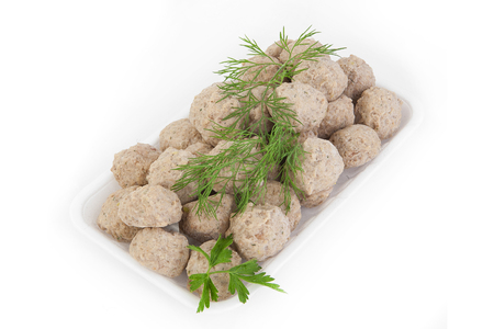 Freshly frozen semi-finished products. Meatballs of tender meat.  Isolate on white background.