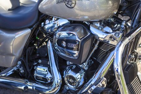 TOLYATTI, RUSSIA, MAY 09, 2018: show of bikers dedicated to Victory Day. Shiny chrome motorcycle engine block Yamaha, Honda. Reflection of people in a chrome plated surface.