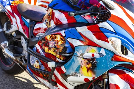 TOLYATTI, RUSSIA, MAY 09, 2018: motorcycle show of bikers dedicated to Victory Day. Bike painted in colors of the American flag.
