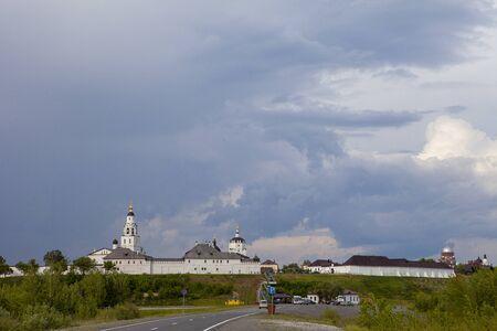 Cloudy sky over island city Sviyazhsk. Historical island-hail. White wall building. Dark gray sky. Editorial