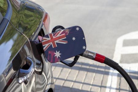 Flag of Australia on the car's fuel tank filler flap. Fueling car with petrol pump at a gas station. Petrol station. Gasoline and oil products. Close up.