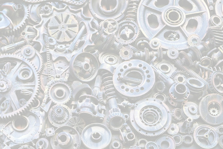 Steampunk background, machine parts, large gears and chains from machines and tractors. Old rusty machine parts. Springs, bearings, pistons, crankshafts, camshafts.