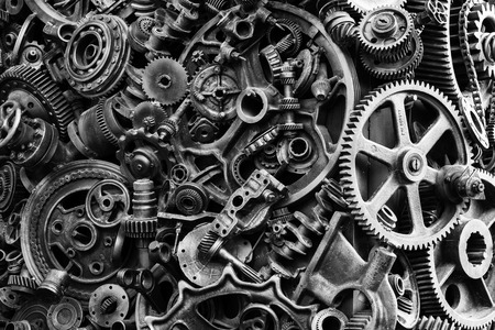 Steampunk texture, backgroung with mechanical parts, gear wheels, steam punk cogwheels, heap of auto parts, old rusty iron chains, springs, wheels, close up