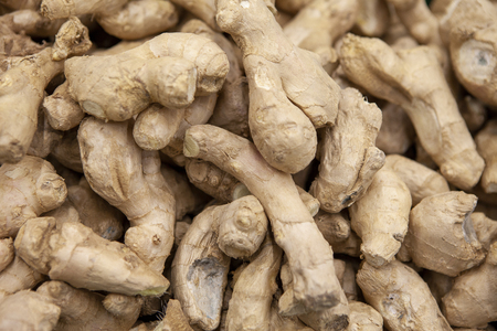 Fresh ginger root for food background.