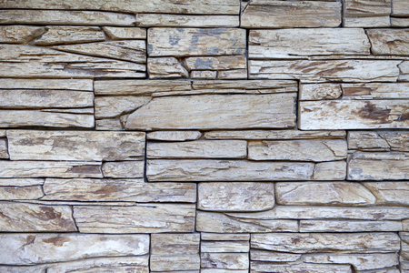 Old stone wall texture. Modern style of architecture. Stock Photo
