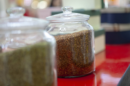 Tea blends in glass jars on the counter of the cafe.