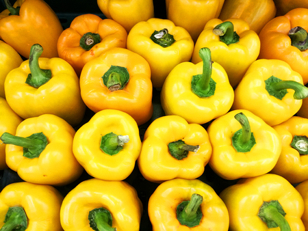 Fresh raw yellow capsicums in the supermarket Stock fotó