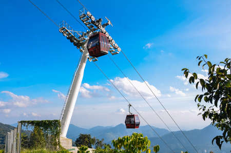 Cable cars are climbing the mountain Stock Photo