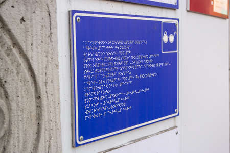 A sign for the blind at the entrance to the organization,