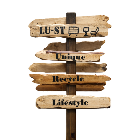 lust: Signpost with the words Lust, Unique, Recycle, Lifestyle printed in black on wooden directional arrows, isolated, on white background, with path.