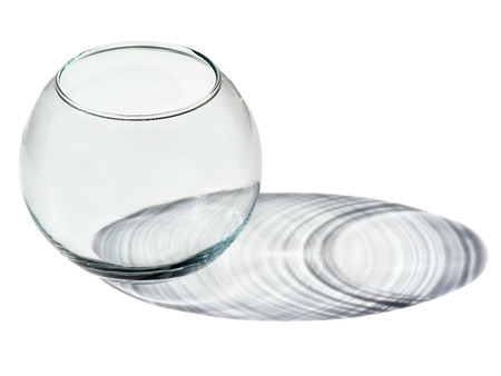 An Empty Round Transparent Glass Vase With A Shadow On White
