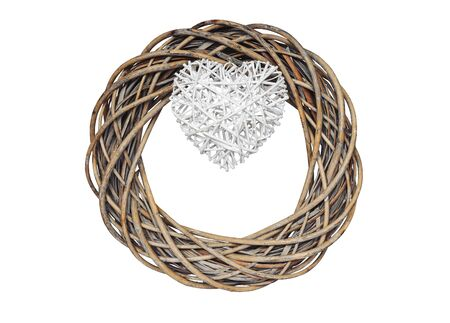 hazel tree: Christmas wreath woven from hazel branches and white woven heart, isolated on white background, clipping path included.
