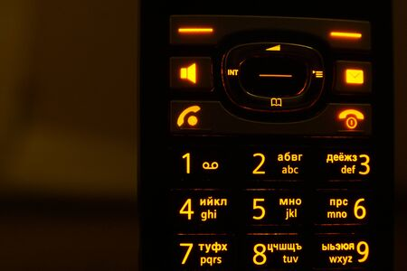 Glowing phone buttons in the dark closeup photo
