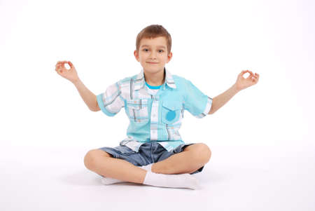 Boy showing yogi, isolated on white background