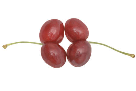 Uncommon cherries on white. Clipping path included. photo