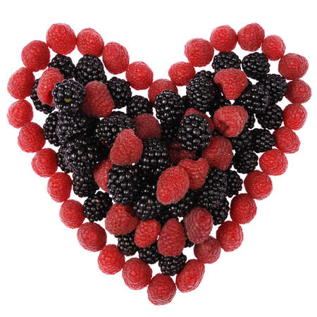 Heart made out of raspberries and blackberries on white background Stock Photo - 11721431