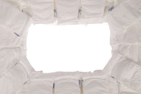 incontinence: Pile of baby diapers on white.