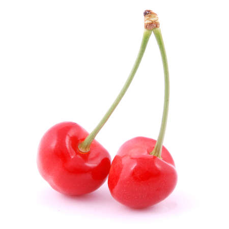 Two red cherries on white background.