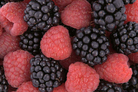 Raspberries and blackberries. fruit background