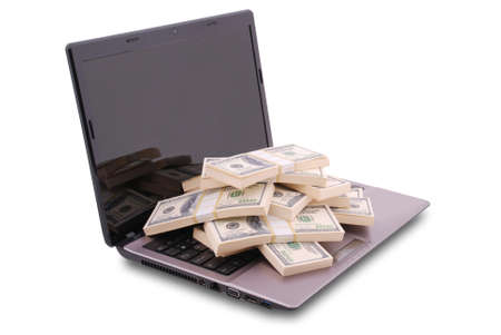 minicomputer: Laptop on white background. Dollars are on the keyboard.  Stock Photo