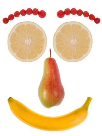 Funny face made from fruit isolated on white. photo