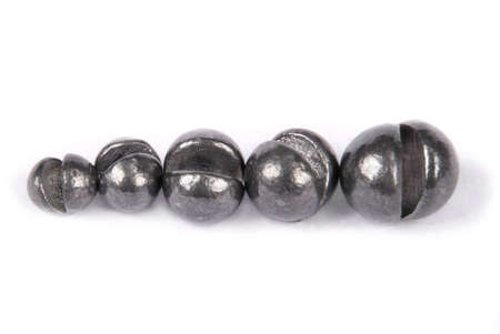 sinkers: Fishing sinkers of different weight isolated on white.