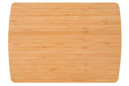 Bamboo kitchen board isolated on white photo