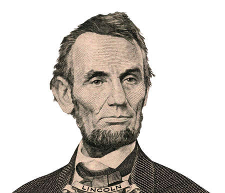 Portrait of former U.S. president Abraham Lincoln as he looks on five dollar bill obverse.