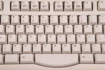 plactic: Gray computer keyboard. One gray technology background. Stock Photo