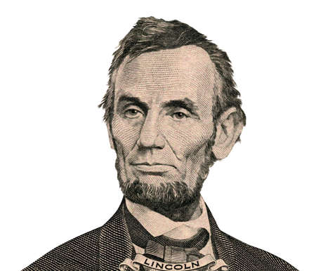 american currency: Portrait of former U.S. president Abraham Lincoln as he looks on five dollar bill obverse. Clipping path inside.