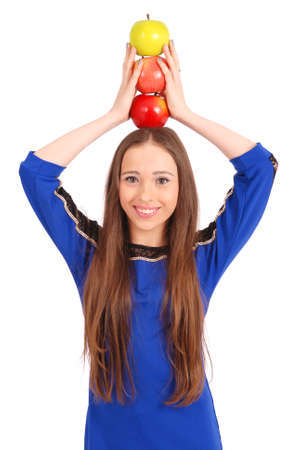 3 persons only: Young girl holds an three apples on her head isolated on white