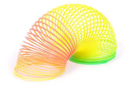 slinky: Slinky spring toy isolated on white. Rainbow spring toy.