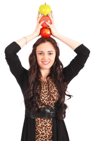 3 persons only: Teen girl holds an three apples on her head isolated on white Stock Photo