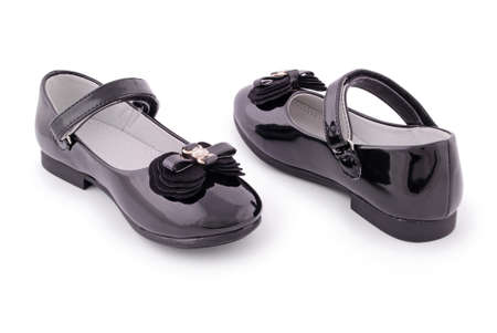Pair of childrens black patent leather shoes.  photo