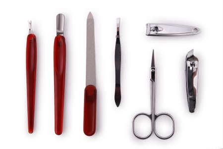 manicura: Herramientas de un conjunto de manicura en un blanco Foto de archivo