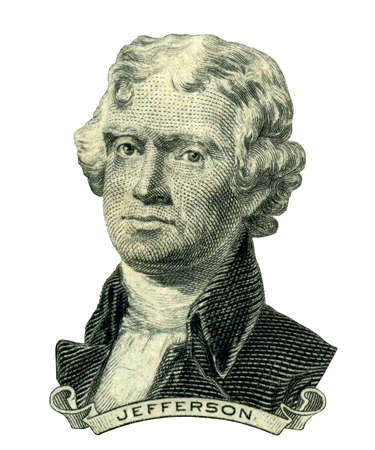 us paper currency: Portrait of former U.S. president Thomas Jefferson as he looks on two dollar bill obverse. Clipping path inside.  Stock Photo