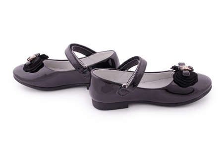 patent leather: Pair of childrens black patent leather shoes. Clipping path included.