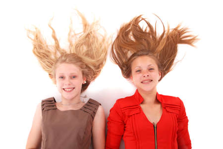 studio model: Two young girls with scattered long hairs, isolated on white