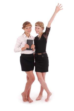 pcs: Girls holding tablet PCs lifting arm isolated on white