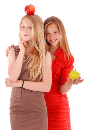 two girls: Two girls holding fresh apples isolated on white