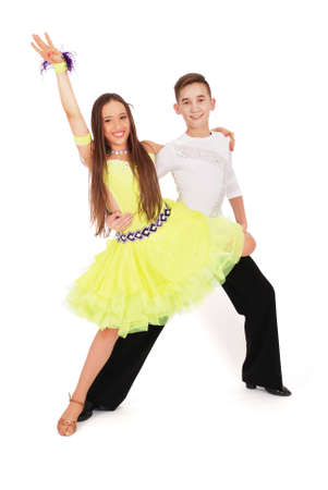 beautiful boy: Boy and girl dancing ballroom dance on white background Stock Photo