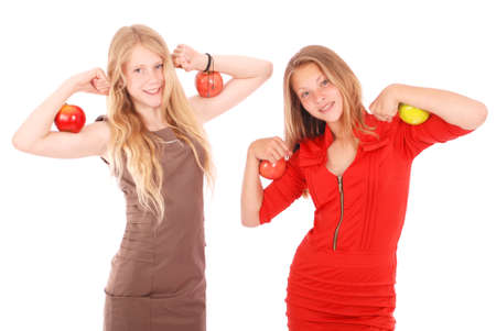 child model: Two girls holding apples on her biceps. Isolated on white.