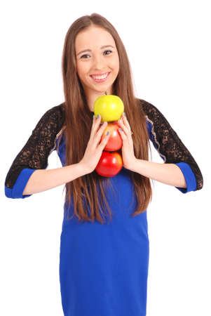 3 persons only: Young smiling brunette girl holding three apples isolated on white