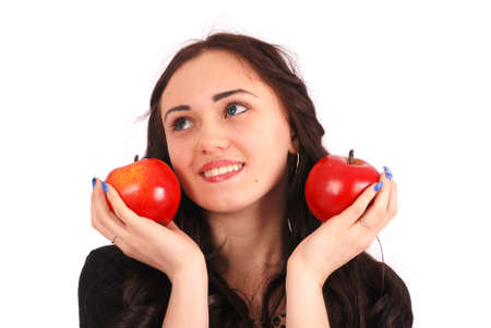 2 persons only: Teen girl holds near the face apples isolated on white Stock Photo