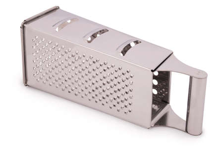 metal grater: One kitchen metal grater isolated on white. Clipping path included.