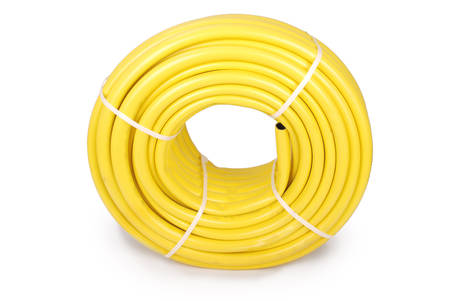 hydraulic hoses: Garden water hose rolled up in a tangle isolated on white